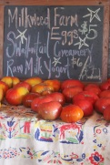 farm store sign and tomatoes